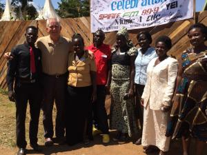 Standing in front of Spirit 99.9 FM in Yei with some of our 20 staff members. Average pay is about $150/month. Most have not finished high school. After some months of on the job training many leave us for better paying jobs working for International Relief Organizations.